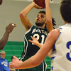 Norman North's Malcolm Carter takes a shot at the basket during the Timberwolves' game against Guthrie at the McGuinness Classic.<br /> Kyle Phillips/The Transcript