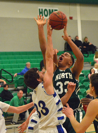 Norman North's Payton Prince gets stopped on a shot by Guthrie's Bailey Nichols during the Timberwolves' game against the Blue Jays Saturday at the McGuinness Classic.<br /> Kyle Phillips/The Transcript