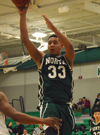 Norman North's Payton Prince  takes a shot at the basket during the Timberwolves' game against Guthrie at the McGuinness Classic.<br /> Kyle Phillips/The Transcript