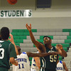 Norman North's Kairo Rutledge tries to get a hand on a rebound Saturday  during the Timberwolves' game against Guthrie at the McGuinness Classic.<br /> Kyle Phillips/The Transcript