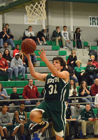 Norman North's Tye Neubauer takes a shot at the basket during the Timberwolves' game against Guthrie Saturday at the McGuinness Classic.<br /> Kyle Phillips/The Transcript