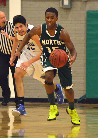 Norman North's Marcus Dicksinson breaks down the court after stealing the ball during the Timberwolves' game against Guthrie at the McGuinness Classic.<br /> Kyle Phillips/The Transcript
