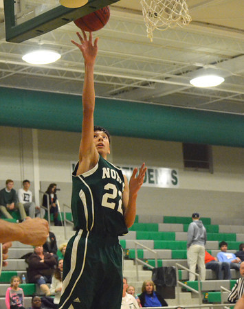 Norman North's Lindy Waters takes a shot at the basket during the Timberwolves' game against Guthrie at the McGuinness Classic.<br /> Kyle Phillips/The Transcript
