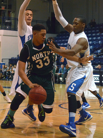 Norman NOrth's Peyton Prince (33) drives toward the goal during the Timberwolves' game against Southeast Saturday at the Shawnee Shootout.<br /> Kyle Phillips/The Transcript