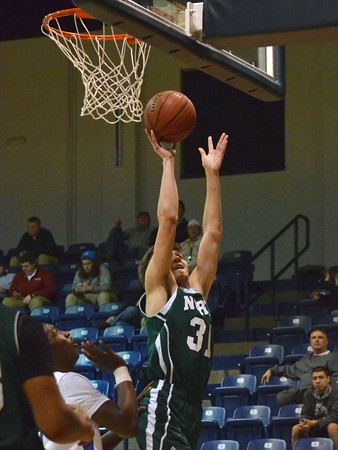 Norman North's Tye NueNeubauer (31) shoots the ball Saturday during the Timberwolves' game against the Spartans.<br /> Kyle Phillips/The Transcript