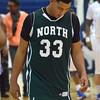 Norman North's Payton Prince hangs his head as he walks off the court Saturday after the Timberwolves lose to Southeast during the championship game of the Shawnee Invitational.<br /> Kyle Phillips/The Transcript