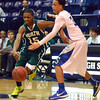 Norman North's Marcus Dickenson (15) drives toward the basket  Saturday during the Timberwolves' game against the Spartans.<br /> Kyle Phillips/The Transcript