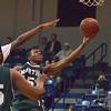 Norman North's Marcus Dickenson (15) takes a shot at the basket Saturday during the Timberwolves' game Saturday against Southeast during the Shawnee Shoutout.<br /> Kyle Phillips/The Transcript