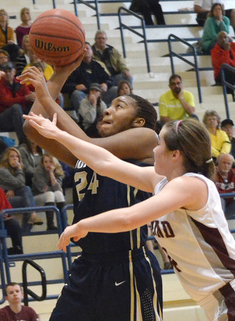 Southmoore's Kyeria Hannah(24) shots the ball during the Sabercats' game against Edmond Memorial Saturday during the Regional Tournament at Southmoore High School.<br /> Kyle Phillips/The Transcript