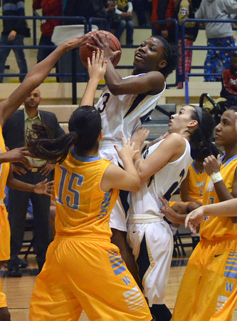 Southmoore's Cydni Hawkins takes a shot over a hoard of PC West players Thursday as the Sabercats take on the the Patriots during the Southmoore Regional Tournament at Southmoore High School.<br /> Kyle Phillips/The Transcript