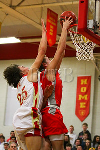Judge Memorial's Kaden Ellis (25) trys to block Bountiful's Sam Merrill (5) dunk. Bountiful beats Judge 73-44.