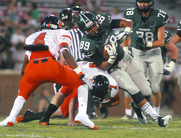 Norman North's Payton Prince tries to slip around the Norman High defense Thursday during the Clash football game at Owen Field.<br /> Kyle Phillips/The Transcript