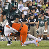 Norman North's Payton Prince is tackled by a NOrman High player Thursday during the Clash football game at Owen Field.<br /> Kyle Phillips/The Transcript