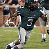 Norman North's Bryan Payne (3) runs with the ball Thursday during the Clash football game at Owen Field.<br /> Kyle Phillips/The Transcript