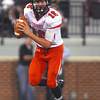 Norman High quarterback Zach Long (16) looks for an open receiver Thursday during the Clash football game at Owen Field.<br /> Kyle Phillips/The Transcript