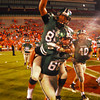 Norman North football players celebrate after winning a game against Norman High Thursday during the Clash football game at Owen Field.<br /> Kyle Phillips/The Transcript