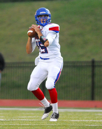 Moore High quarterback Colin Webb (15) looks for an open receiver as he gets ready to pass the ball Friday during the Lion's game against Southmoore at Moore Stadium.<br /> Kyle Phillips/The Transcript