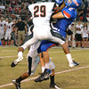 Moore High School's Evan Sprayberry (2) tries to bring in a pass Friday night during the Moore War football game.<br /> Kyle Phillips/The Transcript