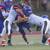 Moore High School quarterback Derek Harris (3) get wedged between two Westmoore defenders as he runs with the ball during the Moore War football game Friday evening at Moore Stadium.<br /> Kyle Phillips/The Transcript