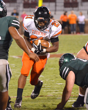 Norman High's Imond Robinson (21) carries the ball on a rush Thursday during the Clash football game at Owen Field.<br /> Kyle Phillips/The Transcript