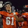 Norman High's Conner Anderson (61) and Jordan Davis (64) celebrate after the Tigers score a touchdown during thier game against Yukon Friday at Harve Collins Field.<br /> Kyle Phillips/The Transcript