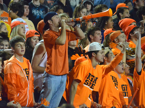 Norman High fans cheer for the Tigers from the stands  Friday during the thier game against the Yukon at Harve Collins Field.<br /> Kyle Phillips/The Transcript
