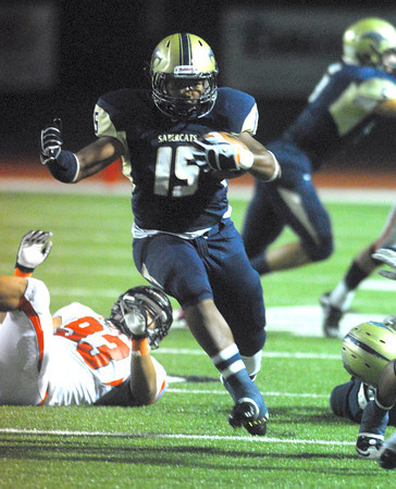 Southmoore running back Karltrell Henderson (15) runs with the ball Friday during the Sabercats' game against Norman High at Moore Stadium.<br /> Kyle Phillips/The Transcript