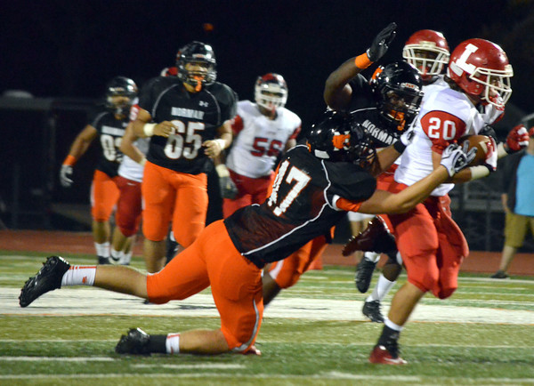 The Norman High School defense pulls down a Lawton ball carrier as he runs down the field Friday during the Tigers' game against Lawton at Harve Colins Field.<br /> Kyle Phillips/The Transcript