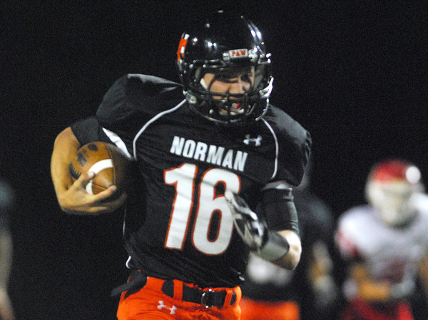 Norman High quarterback Zach Long (16) runs with the ball  Friday during the Tigers' game against Lawton at Harve Collins Field.<br /> Kyle Phillips/The Transcript