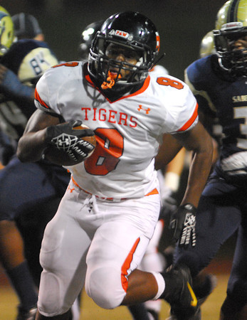 Norman High's A'erion Hines (8) breaks through a hole in the Southmoore defense Friday as he runs with the ball during the Tigers' game against the Sabercats at Moore Staduim.<br /> Kyle Phillips/The Transcript