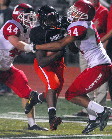 Norman High's A'erion Hines (8) runs through the Lawton defense  Friday during the Tigers' game against the Wolverines at Harve Collins Field.<br /> Kyle Phillips/The Transcript