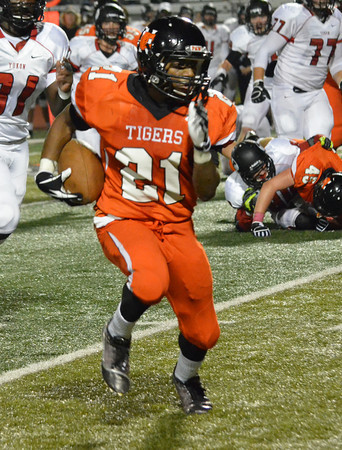 Norman High running back Imond Robinson (21) runs with the ball during the Tigers' game against Yukon Friday at Harve Collins Field.<br /> Kyle Phillips/The Transcript