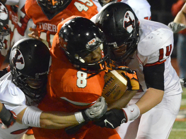 Norman High A'enon Hines (8) tries to push through the Yukon defense Friday night during the Tigers' game against the Millers at Harve Collins Field.<br /> Kyle Phillips/The Transcript