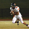 Norman High's Skylar Calhoun (24) runs with the ball in a kickoff return Friday during the Tigers' game against Southmoore High School at Moore Stadium.<br /> Kyle Phillips/The transcript