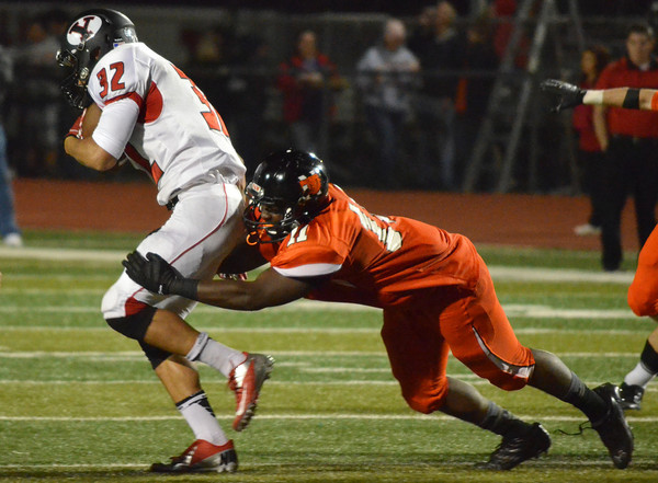 Norman High defender Blake Dean (11) tackles Yukon's Quan Neal (32)Friday night as the Tigers' take on the Millers at Harve Collins Field.<br /> Kyle Phillips/The Transcript