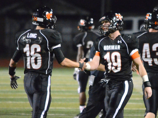 Norman High quarterback Zach Long (16) celebrates with Michael Beard (19) after the Tigers score a touchdown Friday during the thier game against the Millers at Harve Collins Field.<br /> Kyle Phillips/The Transcript
