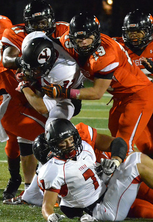 Norman High's Michael Beard (19) brings dewn a Yukon players Friday night as the Tigers' take on the Millers at Harve Collins Field.<br /> Kyle Phillips/The Transcript