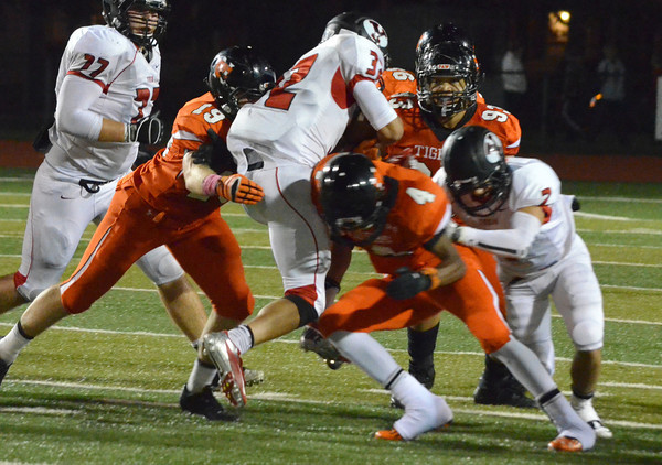 The Norman High defense takes down Yukon's quarterback for a sack Friday night as the Tigers' take on the Millers at Harve Collins Field.<br /> Kyle Phillips/The Transcript