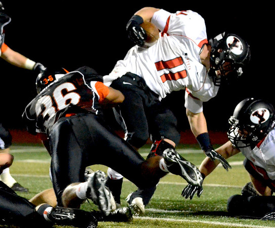 Norman High's Tywon James (36) tackles Yukon's Blake Biggs (11) Friday during the Tigers' game against the Millers at Harve Collins Field.<br /> Kyle Phillips/The Transcript