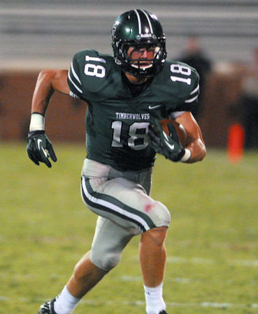 Norman North's Tyler Sipe (18) runs with the ball Thursday during the Clash football game at Owen Field.<br /> Kyle Phillips/The Transcript