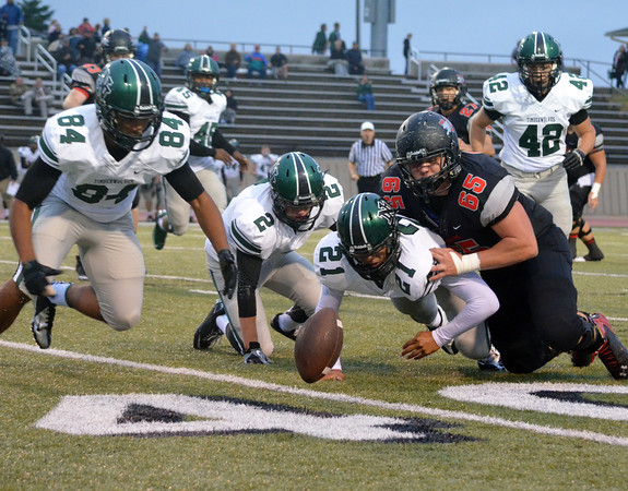 Norman NOrth defenders scramble to get to a loose ball before Westmoore during the Timberwolves' game against the Jaguars Thursday at Moore Stadium.<br /> Kyle Phillips/The Transcript