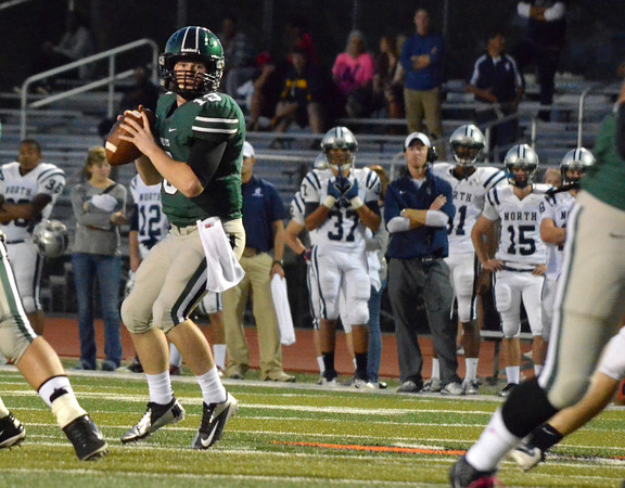 Norman North quarterback Peyton Gravas looks down the field for an open receiver Thursday night during the Timberwolves' game against Edmond North.  Gravas threw for over 400 yards during Norman's victory over the Huskies.<br /> Kyle Phillips/The Transcript