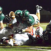 Norman North's Jaxon Uhles (44) leaps over the Yukon defense to score a touchdown Friday during the Timberwolves' game against the Millers at Harve Collins Field.<br /> Kyle Phillips/The Transcript