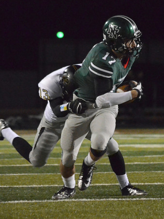 Norman North's Channing Meyer (17) tries to shake off a Broken Arrow defender Friday during the Timberwolves' game against the Tigers at Harve Collins Field.<br /> Kyle Phillips/The Transcript