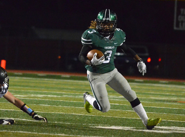 Norman High running back Bryan Payne (3) runs with ball Friday during the Timberwolves' game against Broken Arrow at Harve Collins Field.<br /> Kyle Phillips/The Transcript
