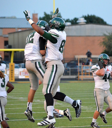 Norman North players celebrate after the Timberwolves score a touchdown agaisnt the Bombers Friday night during their game against Midwest City.<br /> Kyle Phillips/The Transcript