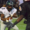 Norman North running back Bryan Payne (3) protects the ball on a run play Friday night during the Timberwolves' game against Midwest City.<br /> Kyle Phillips/The Transcript
