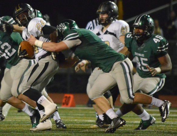 Norman North's Beau Proctor (5) pulls down Broken Arrow's Austin Reed (24) Friday during the Timberwolves' game against the Tigers at Harve Collins Field.<br /> Kyle Phillips/The Transcript
