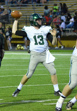 Norman NOrth quarterback Peyton Gavras (13) throws the ball to a receiver during the Timberwolves' game against Midwest City Friday night.<br /> Kyle Phillips/The Transcript