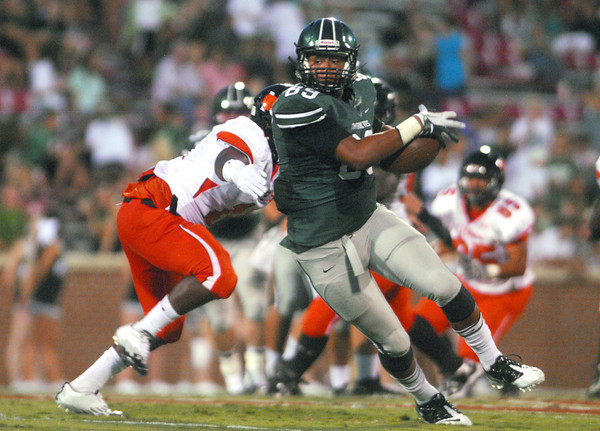 Norman North's Payton Prince (89) tries to get by the Norman High defense Thursday during the Clash football game at Owen Field.<br /> Kyle Phillips/The Transcript